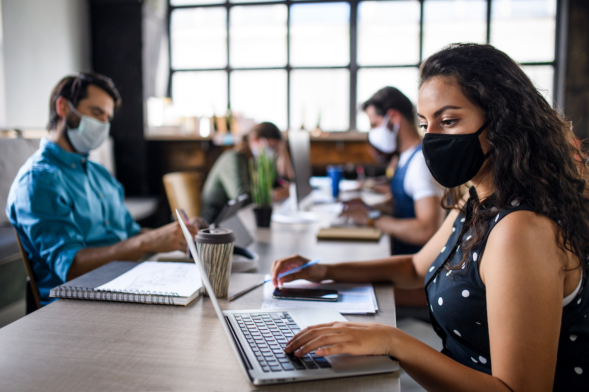 business people with face masks